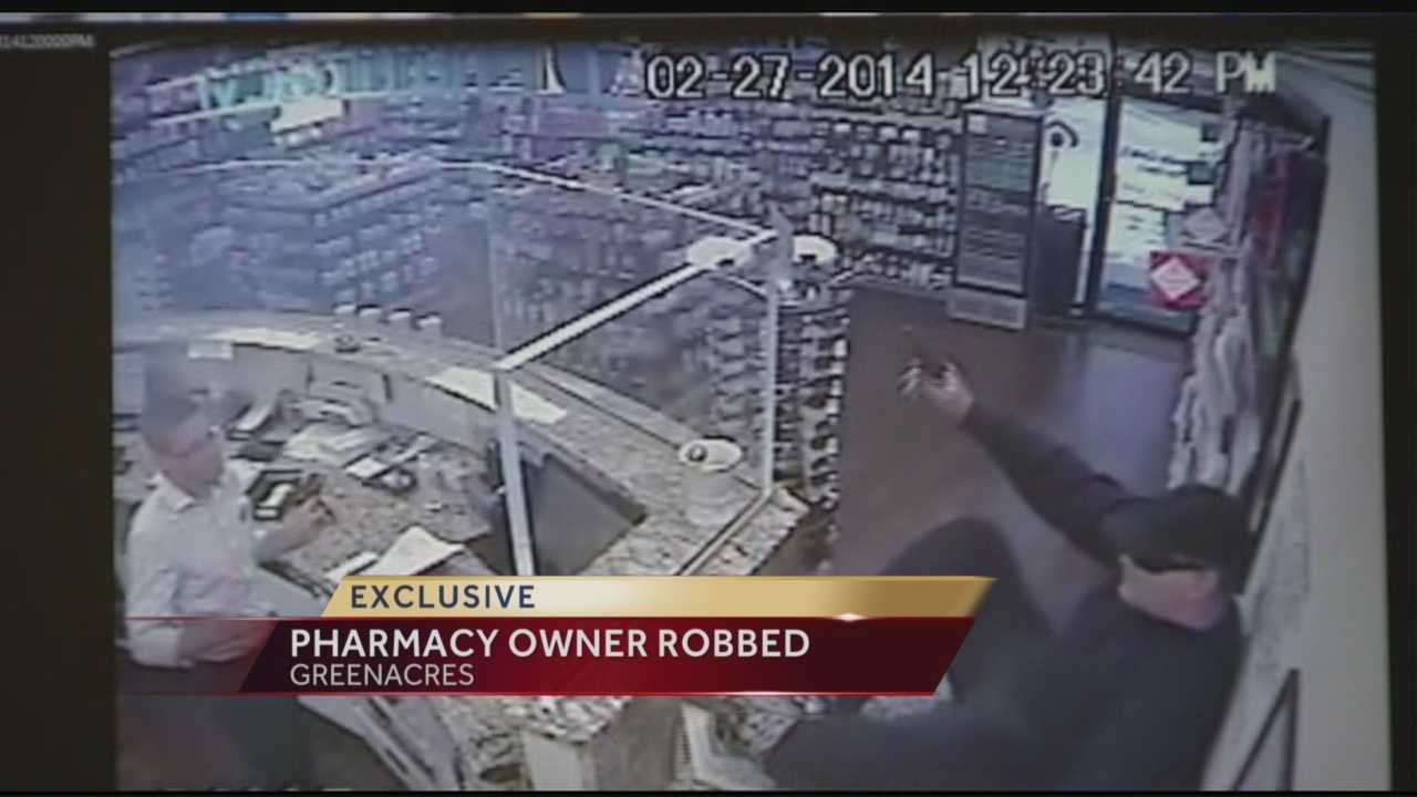 A man with a gun busted into a pharmacy and robbed it, and it was all caught on video.