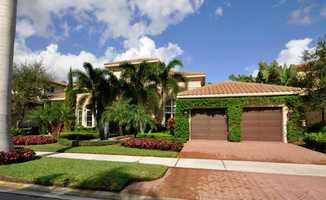 Meticulously groomed landscape surrounds the home. For more information on the 4,862 sq. ft. home, visit Realtor.com .