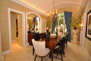Gorgeous dining room features architectural display.