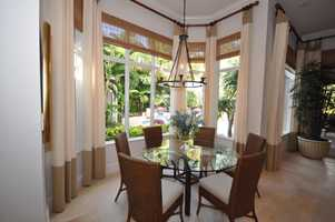 The kitchen's dining nook looks out over the pool.