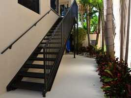 An outdoor staircase takes you directly to the second-floor balcony.