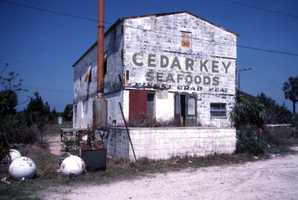 Abandoned Cedar Key Seafoods building in Cedar Key, Florida. (1985)