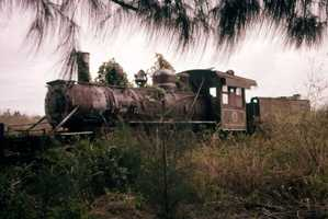 Abandoned locomotive at the deserted lumber town Copeland. (1960)