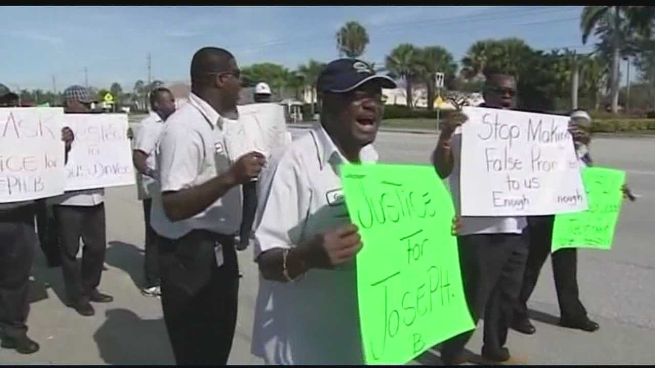 042114 Image Bus drivers protest outside school district after colleague attacked