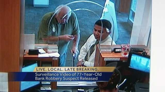 Surveillance video just released shows a 77-year-old man robbing a bank with a knife last Friday.
