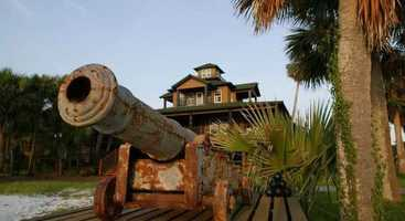 The island includes 26 luxury bungalows connected by a boardwalk to a four-story, 6,500-square-foot community Big Game Club.