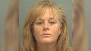 Pompano Beach firefighter Janeen McKenzie was arrested after Palm Beach County Sheriff's say she pointed a gun and fired at a man she met and brought home from a bar. McKenzie faces charges of aggravated battery with a firearm.