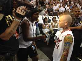 "JUNE 12: A young Chris ""Birdman"" Anderson fan weighs in with Angela Rozier on the Heat's chances in Game 4."
