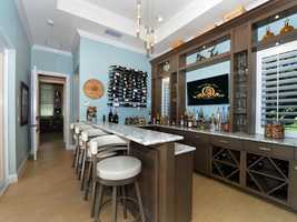 Pass the kitchen and you'll find a chic, full service bar.