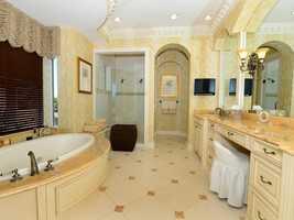 The master bathroom boasts a spacious spa tub.