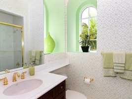 The adjoining full bathroom is very bright.