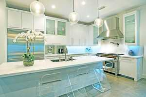 Gourmet kitchen boasts high end appliances, gas range stove, and quartz counter tops.