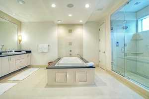 Master bathroom features an impressively large free-standing spa tub.