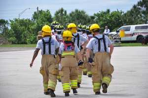 The company of recruits walk to their flashover exercise.