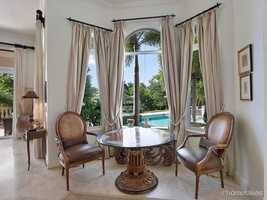 Picture perfect dining room overlooks the pool view.