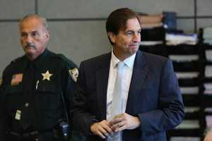 John Goodman glances back at someone in the courtroom as he arrives for the first day of his retrial Saturday, October 11, 2014. Goodman is charged with DUI manslaughter in the death of Scott Wilson. (Lannis Waters / The Palm Beach Post)