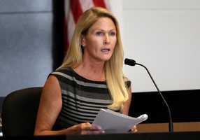 Heather Hutchins, John Goodman's girlfriend, hold a copy of phone records from the civil trial as she answers questions from prosecutor Alan Johnson of on the second day of John Goodman's retrial Monday, October 13, 2014. Goodman is charged with DUI manslaughter in the death of Scott Wilson. (Lannis Waters / The Palm Beach Post)