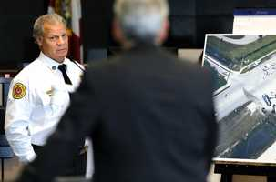 Scott Bielecky, retired Palm Beach County Fire-Rescue captain is questioned by prosecutor Alan Johnson about his actions at the scene of the crash, at right, on the second day of John Goodman's retrial Monday, October 13, 2014. Goodman is charged with DUI manslaughter in the death of Scott Wilson. (Lannis Waters / The Palm Beach Post)