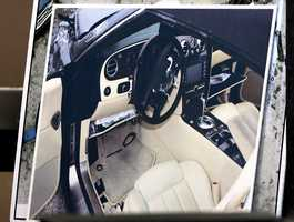 A photo of the interior of John Goodman's Bentley after the crash is shown during testimony of investigator Troy Snelgrove during the sixth day of Goodman's retrial Friday, October 17, 2014. Goodman is charged with DUI manslaughter in the death of Scott Wilson. (Lannis Waters / The Palm Beach Post)