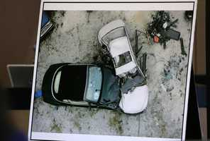 A photo of a reconstruction of the crash is shown during testimony of investigator Troy Snelgrove during the sixth day of John Goodman's retrial Friday, October 17, 2014. Goodman is charged with DUI manslaughter in the death of Scott Wilson. (Lannis Waters / The Palm Beach Post)