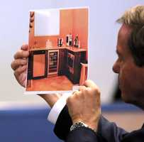 """Defense attorney Douglas Duncan shows Kris Kampsen the bar area of his office, also known as the """"man cave"""", as Kampsen testifies on the ninth day of John Goodman's retrial Tuesday October 21, 2014. Goodman is charged with DUI manslaughter in the death of Scott Wilson. (Lannis Waters / The Palm Beach Post)"""