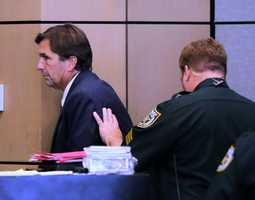 John Goodman is led from the courtroom Tuesday after the jury found him guilty October 28, 2014. (Lannis Waters / The Palm Beach Post)