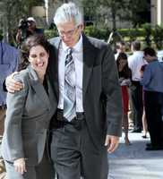 Prosecutors Sherri Collins and Alan Johnson hug after a press conference fooling John Goodman's conviction for DUI manslaughter with failure to render aid in the death of Scott Wilson. (Lannis Tuesday, October 28, 2014 after the jury Waters / The Palm Beach Post)