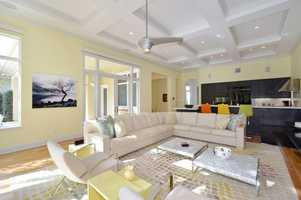 Comfortable family room with easy access to the pool and kitchen.