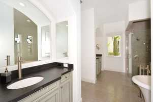 Individual vanities provide ample private space for couples.