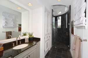 Recessed lighting in this en suite bathroom.