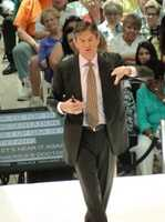 """Dr. Oz on stage outlines the """"Top 10 questions that you need answers to right now."""""""