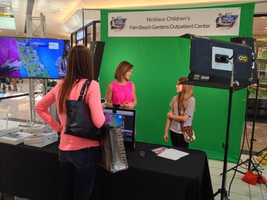 Photo Mike Lyons: @wpbf_sandra at the weather wall #drozfest