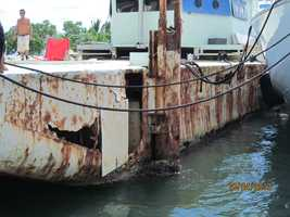 Holes in barge hull.