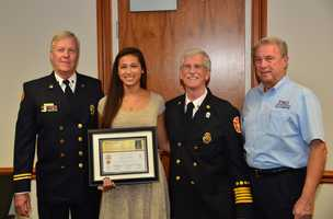 Essay-4 = L-R Palm Beach County Fire Captain (retired) Steen Ericsson, Third Place Winner Alexis Simm, Palm Beach Gardens Fire Chief Michael Southard, Palm Beach Gardens Police Foundation President Tom Murphy.