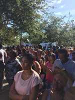 Crowd listening to the rally organizers speak.