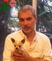 Director of Engineering Cliff Thomas and his dog Pepito.