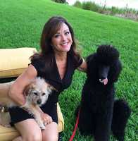WPBF 25 News reporter Terri Parker and her dogs Gemma, on the left, and Beau.