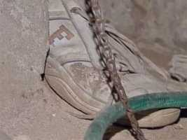 This worn and dirty shoe is another example of the torturous conditions in which the victims were confined.