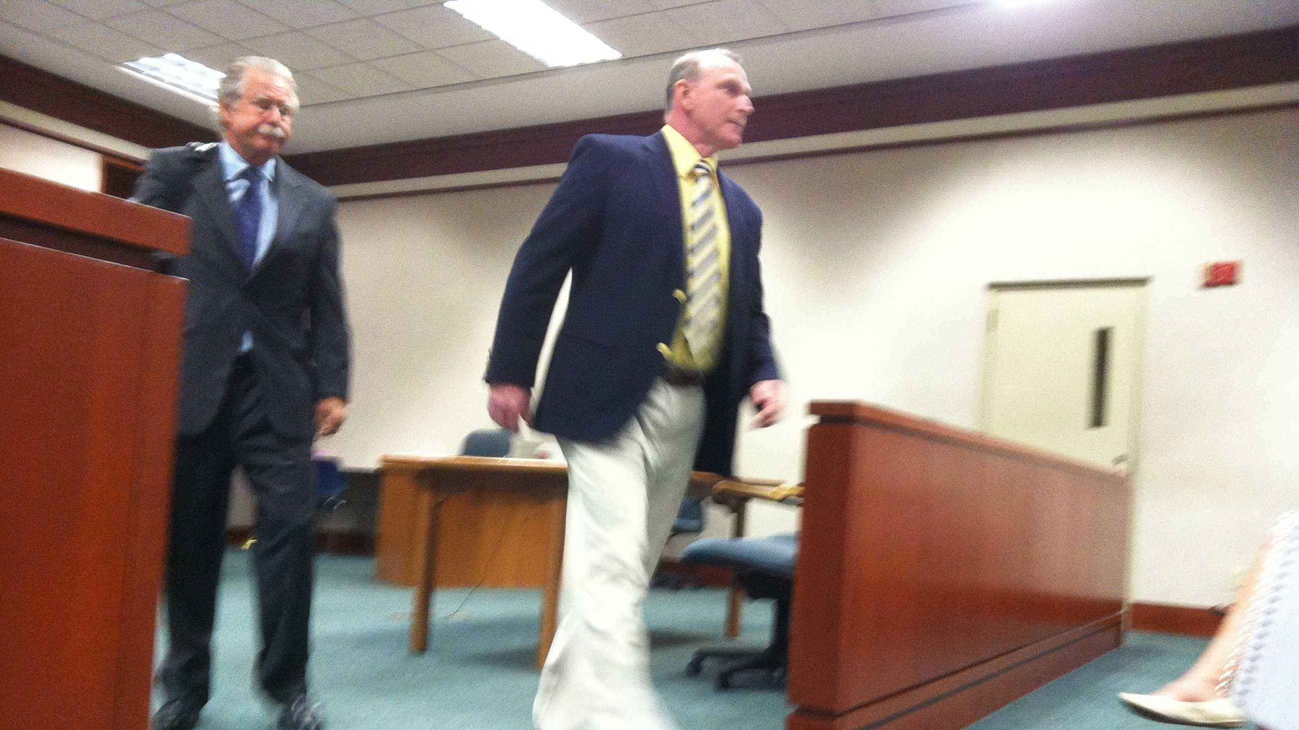 Jim Deeghan (R) with his lawyer after his arraignment