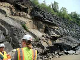 Crews look at a rockslide that covered portions of I89 in Williamstown.