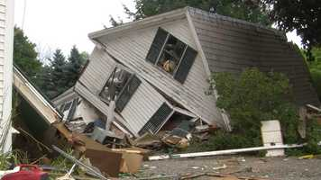 A two-story home exploded early Wednesday morning, sending debris hundreds of feet into the air.