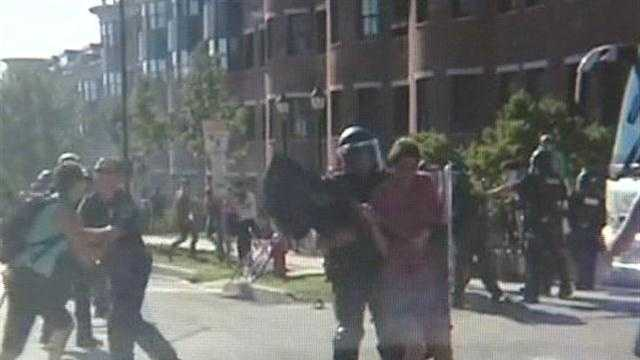 Burlington Police say pepper balls and a sting ball were fired to protect two officers from protesters at the 36th annual meeting of the New England governors and eastern Canadian premiers.