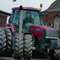 Roger Fawkes sits in his tractor.