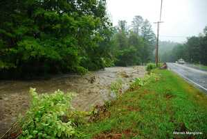 The Williams River raged along Rt. 11 near Chester.