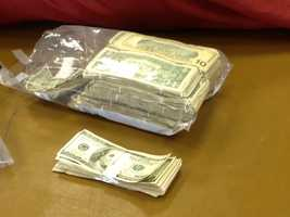 Stacks of money collected as evidence in a Malone drug bust.