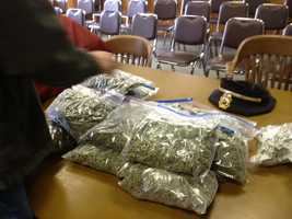 Authorities layout bags of pot collected as evidence in a drug bust in Malone.