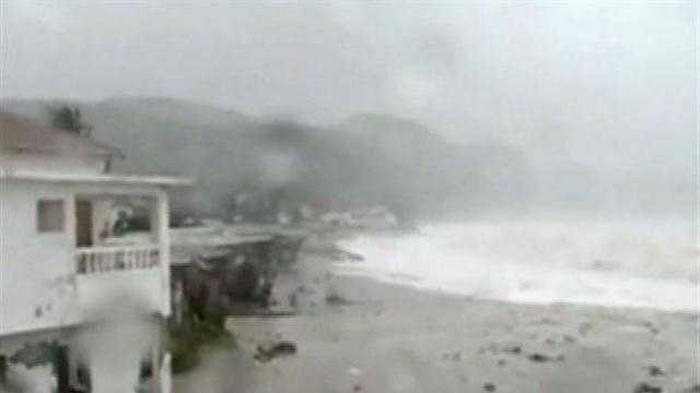 Sandy also killed a man in Jamaica on Wednesday when a boulder crashed through his house.