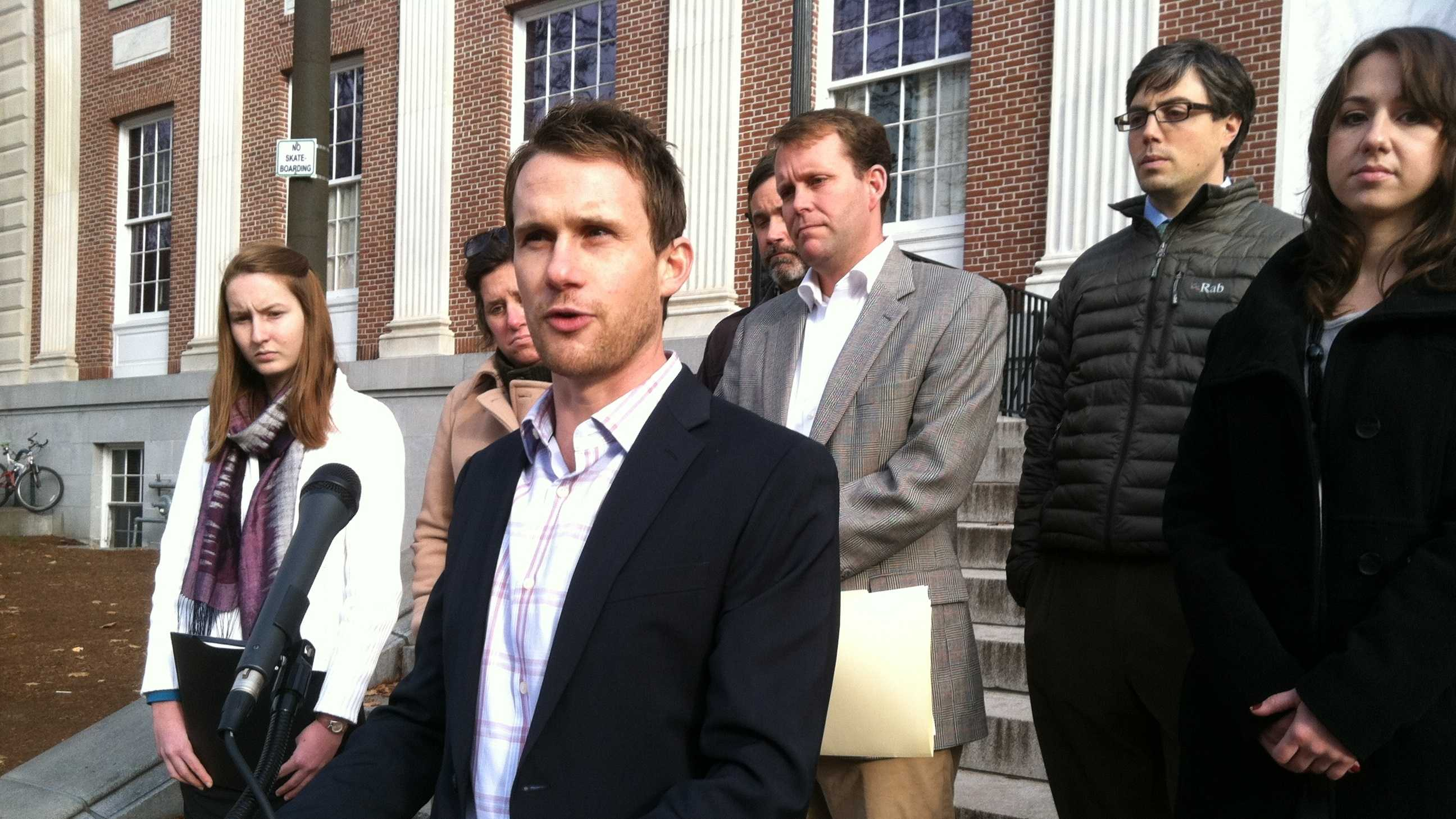 Andrew Savage, a Democratic activist, holds news conference outside City Hall to push for greater state regulation of super PACs.