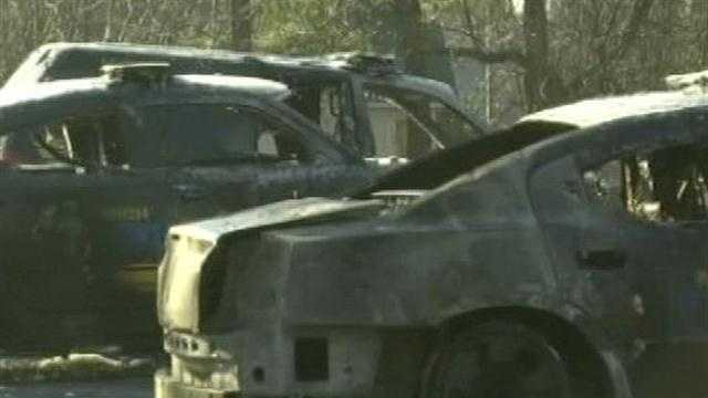 Police cruisers destroyed in mysterious fire