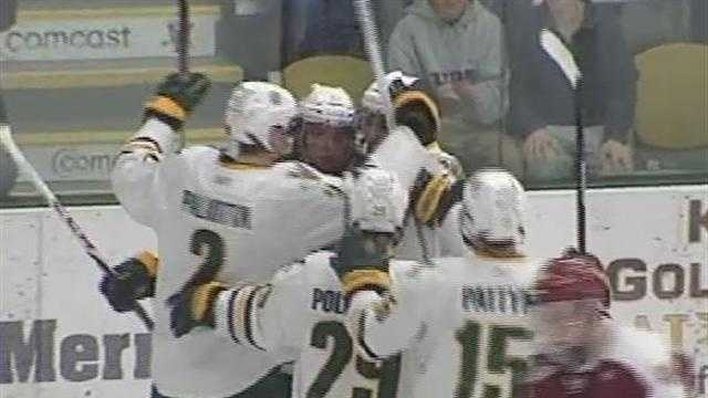 012713 UVM men women hky- img